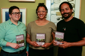 Alexis Whitham, left, Frameline's director of educational programming and acquisition, holds the 2013-2014 Youth in Motion collection along with Taylor Hodges, Youth in Motion outreach coordinator, and Jason Boyce, Frameline's digital media coordinator. (Photo: Elliot Owen)